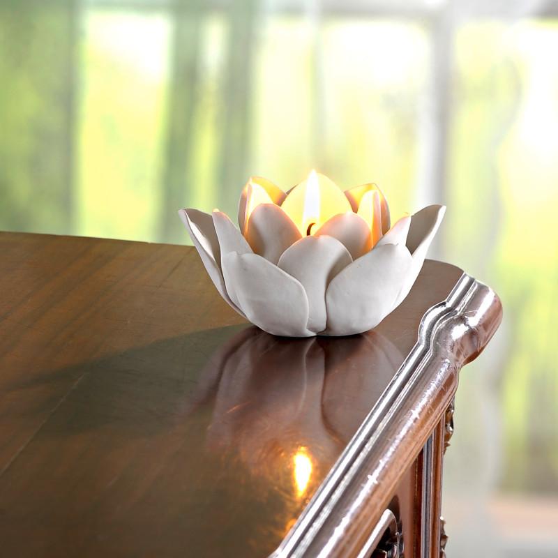 Świeczniki w kształcie kwiatów onerror=