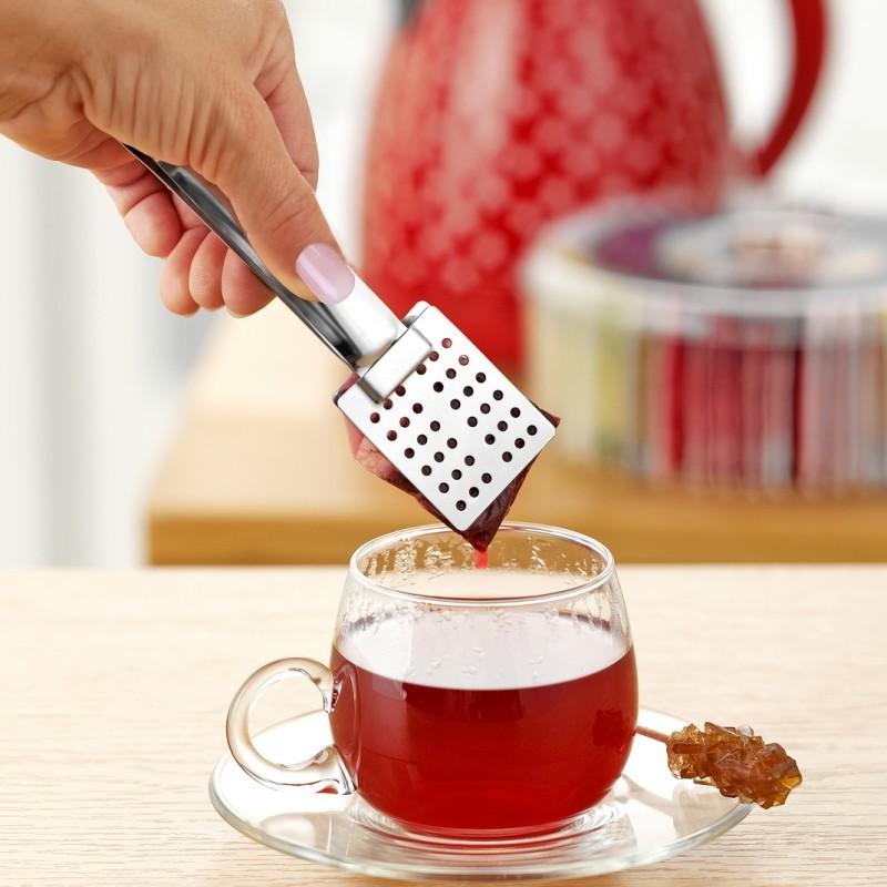 Szczypce do herbaty onerror=