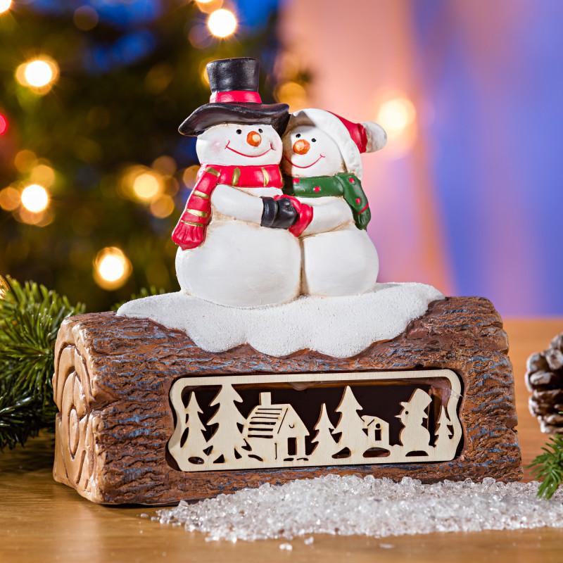 LED drevený kmeň so snehuliakmi