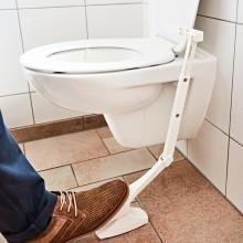 Zvedák víka toalety